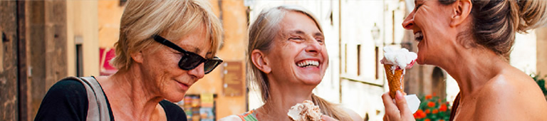retired women eating ice cream and just laughing